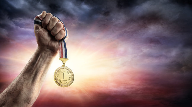 Medal Of First Place In Hand - Victory Concept