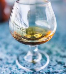 Macro closeup of amaretto, rum, or bourbon drink in glass
