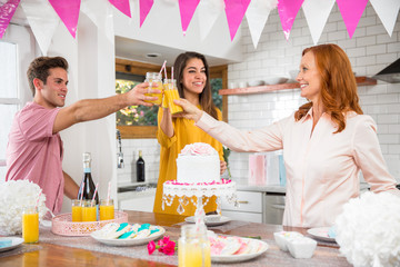Older middle age mom celebrates with her family on her birthday, mothers day, possibly retirement party