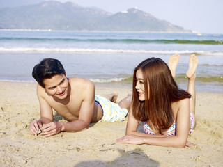 young asian couple on beach
