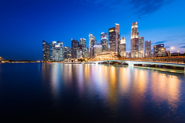 Singapore skyline at night. Central Business District, Fullerton Park at the newly built Jubilee Bridge.