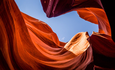 picturesque underground cave. Lower Canyon Antelope and blue sky