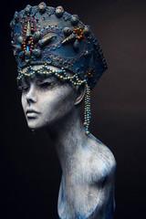 Woman in creative blue crown