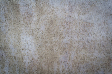 Spot gray paint on textured metall wall background