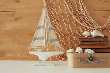Nautical concept with sea life style objects on wooden table