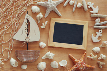 Nautical concept with sea life style objects on wooden table.