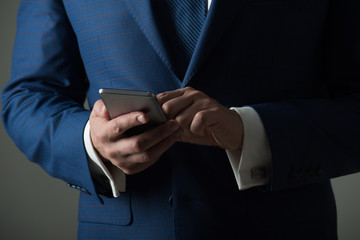 Mobile phone or smartphone in male hands