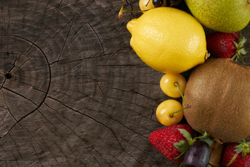 Collection fruits and vegetables isolated on wooden background with copy space. Detox and healthy food concept. Vegetarian food.
