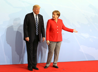 German Chancellor Angela Merkel welcomes US President Donald Trump to the opening day of the G20 leaders summit in Hamburg