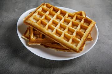 Freshly baked belgium waffles in plate