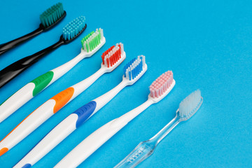 Photo of seven multi-colored toothbrushes