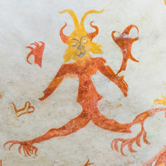 Devil with big claws, a medieval mural