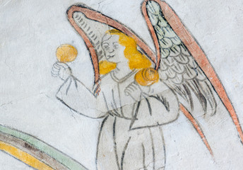 Angel playing maracas, medieval wall-painting