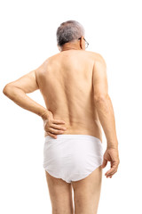 Mature man in underwear suffering from back pain
