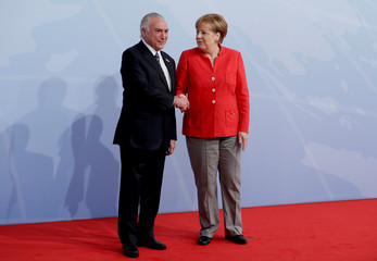 German Chancellor Angela Merkel welcomes Brazil's President Michel Temer to the opening day of the G20 leaders summit in Hamburg