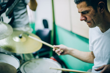 Behind scene. Drummer artist musician playing the drums with drumsticks