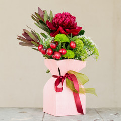 beautiful bouquet of flowers in gift box