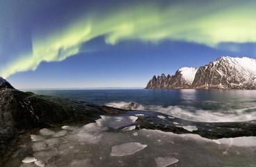 Panorama of frozen sea and rocky peaks illuminated by the Northern Lights (aurora borealis), Tungeneset, Senja, Troms, Norway, Scandinavia, Europe