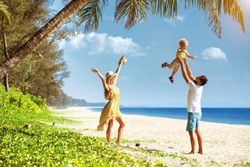 Happy family tropical beach having fun
