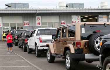 Used vehicles are lined up in lanes before being sold during a dealer-only auction at Manheim Detroit auction house in Carleton, Michigan