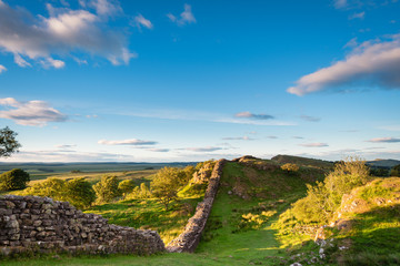 Roman Wall in late evening sun / Hadrian's Wall is a World Heritage Site in the beautiful Northumberland National Park. Popular with walkers along the Hadrian's Wall Path and Pennine Way