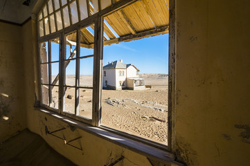 Window of an old colonial house, old diamond ghost town, Kolmanskop (Coleman's Hill), near Luderitz, Namibia, Africa