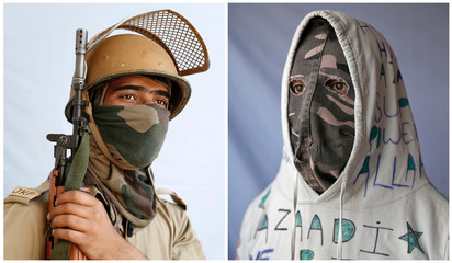 The Wider Image: Kashmir's stone-pelters face off against pellet guns