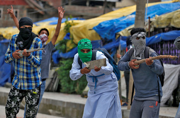 The Wider Image: Kashmir's stone-pelters face off against pellet guns