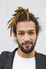 Portrait of young businessman with dreadlocks
