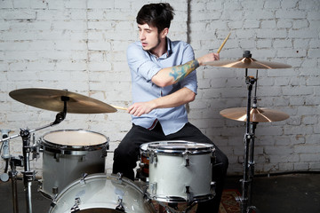 the drummer behind the drums