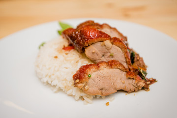 stir-fried roasted duck and basil and fried egg with rice, Thai food