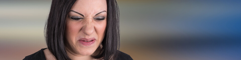 Young woman with an expression of disgust