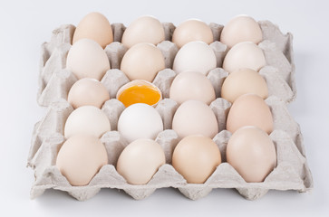 Box filled with eggs, with one broken egg