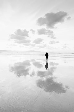 person thinking in the beach looking at sea