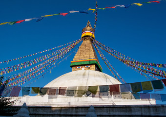 Kathmandu, Nepal: Boudhanath, a huge Buddhist stupa with blue eyes and a sacred prayer flags.