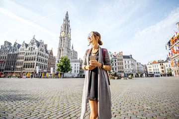 Young woman tourist walking on the Great Market square during the morning in Antwerpen, Belgium Fototapete