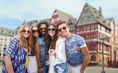 happy hippie friends taking selfie in frankfurt