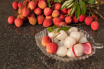 Fresh juicy lychee fruit on a glass plate. Organic leechee sweet fruit. Organic fruit concept. Exotic tropical litschi berry. Peeled lychee fruit. Selective focus.