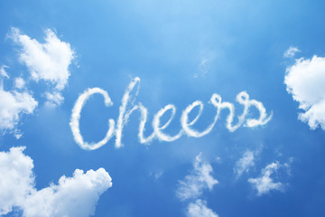 CHEERS hand cloud written word on sky background. Calligraphy style.