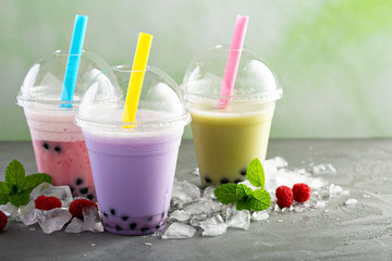 Variety of bubble tea in plastic cups