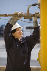 Female engineer working at power plant