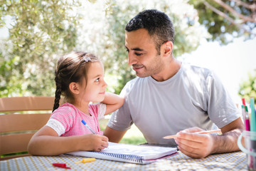 Little Girl And Father Drawing Pictures Together Outdoors In Summer