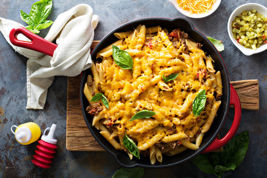 Cheesy pasta bake with ground beef and herbs