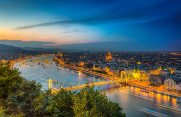 Aerial view of Budapest at night. Hungarian landmarks: Bridges over Danube river in Budapest.
