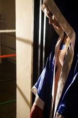 Thoughtful woman wearing boxing robe