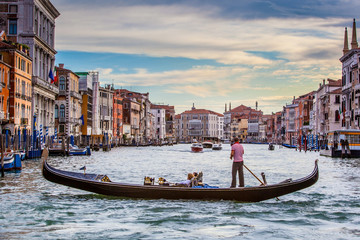 Men In Gondola On Canal In City Against Sky, Venice, Italy