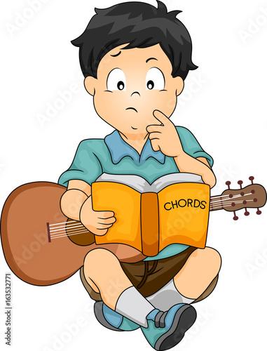 Kid Boy Study Guitar Chords\