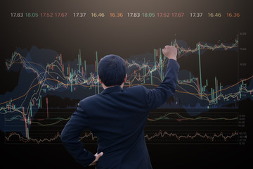 Double exposure business man using technology stock financial indices on currency exchange