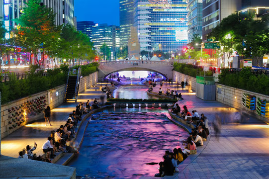 Colorful city lights of Cheonggyecheon Stream Park with Crowd at night in Seoul City, South Korea.