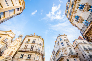 Street view from below on the beautiful buildings and blue sky in Nantes city in France Fototapete